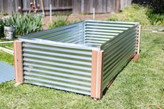 DIY guide on how to build a metal raised garden bed for your garden. This how-to walks you through every step and goes over potential problems and solutions. Metal Raised Garden Beds, Building A Raised Garden, Raised Vegetable Gardens, Home Vegetable Garden, Making Raised Beds, Hillside Garden, Metal Siding, Gardening Magazines, Corrugated Metal