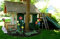 SUPER CUTE flower idea for the playhouse. I wonder if Chappy could build the slide addition on the back?