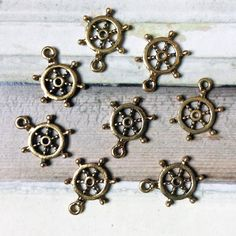 Bulk Lot 25 Ships Wheels charms 22x15mm by MyVintageCharms on Etsy (Craft Supplies & Tools, Jewelry & Beading Supplies, Charms, nautical charms, sailor charms, sailing charms, boating charms, ships wheels, wholesale charms, bulk lot charms, wholesale nautical, bulk ships wheels, goldtone ships wheel, goldtone nautical, bulk lot nautical, uk seller)