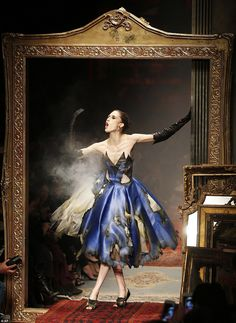 Moschino's Jeremy Scott presented a fiery AW16 collection sending models down the catwalk on scorched dresses that emitted smoke.One model posed in the frame of a mirror as she appeared to leap at the heat of her own dress