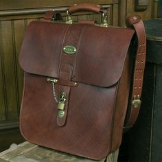 No. 42 Courier Bag for laptop and iPad®    Maybe I've watched Casablanca too many times, but this bag looks as if it should be used to transport secret documents to be exchanged in the middle of a bridge on a foggy night. The lock and chain leave no doubt that the contents are special. $778.50