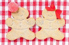 extreme close-up shot of gingerbread couple. - Extreme close-up shot of gingerbread couple on a red tablecloth.