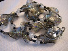 Gray Leaf Twist Beaded Lanyard by lasrmlady on Etsy Beaded Lanyards, Bead Necklaces, Glass Beads, Gray, Unique Jewelry, Bracelets, Handmade Gifts, Vintage, Beaded Necklaces