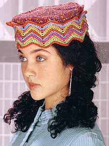 le dessus du chapeau est moche,en le modifiant le chapeau serait magnifique, the hat would be beautifull if the top was modifyed, changed, other motif and yarn.becsaue around the head it is nice.http://whatnot2crochet.com/wordpress/?m=200702