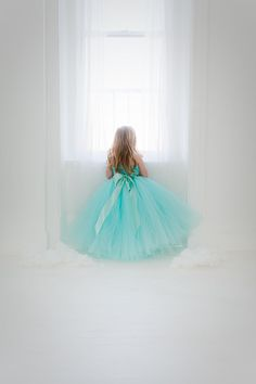 The Grace Dress in Robins Egg Blue - Such a sweet color!! And it looks amazing paired with blushes, silvers, greens... the possibilities are endless!! This full and fluffy dress is fully lined in satin, bodice and skirt, so the tulle will not touch her legs. Plus, the back of the
