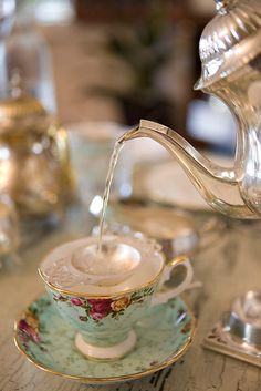 4:00 Tea... What could be more appealing than a Royal Albert teacup and saucer, accompanied by a sterling silver tea pot and strainer!