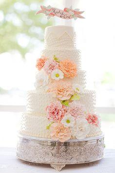 Beautiful peach and white wedding cake