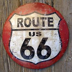 """US Route 66 Rustic Vintage Style Round Dome Tin Street Sign Tin Metal Round Dome Shape road sign which reads US Route 66 •Rustic style with a clear coat finish makes this US Route 66 sign great for indoor or outdoor use •Vintage Style Round Dome Sign measures 12"""" in diameter and protrudes from wall 1 3/4"""" •Great rustic decor to add to your bar, garage, driveway, or hang indoors for that great 50's diner decor •Route 66 sign is Made out of Heavy Gauge Tin With Great Rustic Detail"""