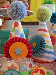 Circus party hats. Could give these out as gifts (with a clown nose and a bowtie, maybe) to get all the kids a bit dressed up.