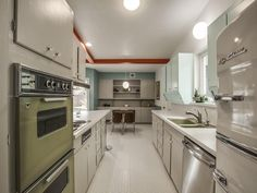 Northeast Dallas' Sparkman Club Estates neighborhood has quite the stock of midcentury modern homes, including this brand new listing from Ed Murchison. Midcentury Front Doors, Midcentury Modern, Cabin Kitchens, Dream Kitchens, Penny Tile Floors, Honeycomb Tile, Mid Century Cabinet, Yellow Tile, Retro Appliances