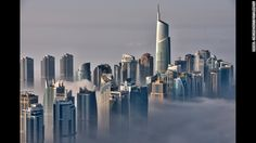 The skyline just along the coastline of the Persian Gulf is seen from the 85th floor of the Princess Tower.