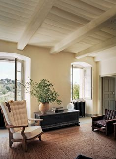 Studio KO architects Karl Fournier and Olivier Marty's Corsican carpenter's cottage is a study in restraint; the duo painted neutral tones throughout the space and adapted a less-is-more approach with their furnishings.