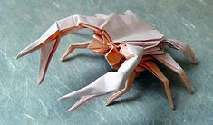 Awesome Origami Crab - http://www.ikuzoorigami.com/awesome-origami-crab/