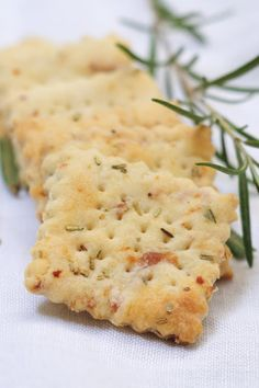 This link leads to several yummy looking cracker recipes. The crackers pictured are rosemary prosciutto