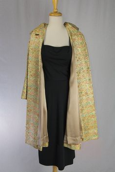 Fabulous vintage 60s Brocade evening coat. This glamorous gold beauty features an exquisite brocade with rich jewel tone floral of reds, pinks and