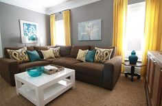 I LOVE the gray walls, brown couch, and teal accents :)
