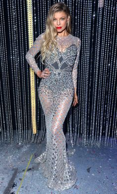 FERGIE in a form-fitting sheer silver gown with sequin embellishments