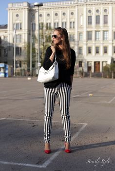 Striped pants and red pumps