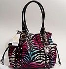 Kathy Van Zeeland purse I want this love the zebra print in different color.