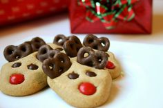 Chocolate covered pretzels for antlers! How smart is that? Peanut Butter Reindeer Cookies, totally going to surprise the hubster with these.