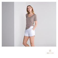 The Luxe White Shorts combined with our V for Versatile Shirt in Nomade Designer Sportswear, Hip Bones, Editorial Fashion, White Shorts, Feminine, Sporty, Zurich, Chic, Women