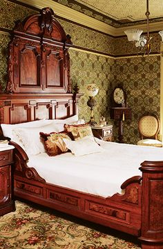 victorian style wallpaper and furniture.