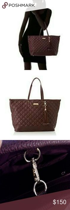 BCBG XL tote Absolutely gorgeous XL tote. Has 4 stud feet, center clasp for closure, detachable tassel. In excellent condition. Pls ask any questions before purchase.  Reduced. BCBG Bags Totes
