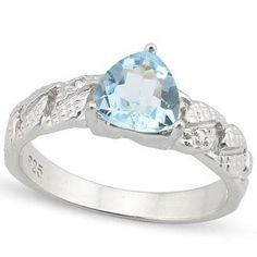 We love the delicate shades of blue found in blue topaz. This ring features a pale 1.34-carat blue topaz and diamond platinum chips arranged in a braid pattern along the band. The trillion-cut stone is a rounded triangular shape, which emphasizes its many facets and gives this piece a sense of shimmering movement, like a gentle tide.