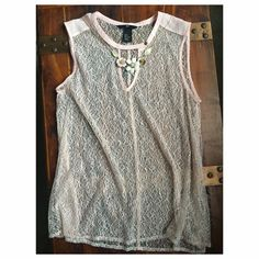 H & M : Sheer Pink Top, Medium H&M : Sheer Pink Top, Medium, size 6. Sleeveless top with slight V, metal clasp crew neck detail. Wear with a white or beige cami, dress up with your favorite jewelry! (Necklace not included w/ purchase). Worn to a wedding, hand washed. H&M Tops