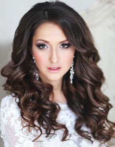 Longer Style http://www.modwedding.com/2014/01/16/21-classy-and-elegant-wedding-hairstyles/