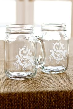 DIY Monogrammed Mason Jars...multiple jars & candles. Great idea for entertaining on the patio.