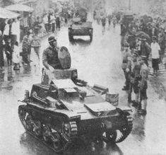 Japanese forces enter the French Concession, Shanghai, July 1940. The vehicle in the foreground is a Type 94 tankette.