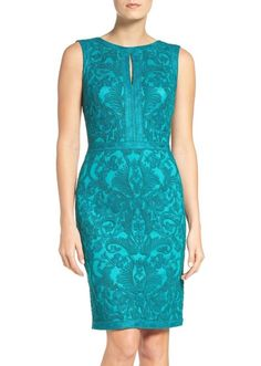"By Tadashi Shoji; imported. Embroidered Sheath Dress. Color: Aqua. 60% rayon, 20% nylon, 20% polyester. Jewel neck with keyhole cutout. Dry clean. • Chest: 38"". 