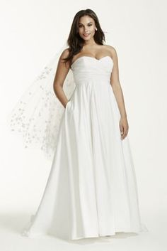 One of the many beautiful things about a wedding dress is that it's a perfect blank canvas for you to accessorize. This strapless faille ball gown with a sweetheart neckline, sweep train, and empire waist will inspire you to create a look that's all your own.   David's Bridal Collection - Plus Size.  Also available in Regular,Extra Length and Plus Size Extra Length. Check your local stores for availability  Sweep train. Fully lined. Imported. Back zip with button detail. Dry Clean