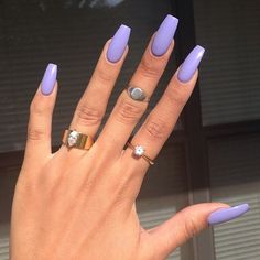 I LOVE this color. And the length/shape of her nails.