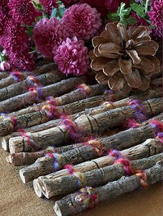 Twig trivet ~ Simply cut twigs to length, tape together to hold, then wrap with yarn, over and under -alternating rows to secure the twigs into a flat square for your trivet.  Very rustic and cute for cook-outs or a casual meal!