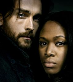 "Tom Mison as Ichabod Crane and Nichole BeHarie as Abbie Mills from the TV Show ""Sleepy Hollow""."