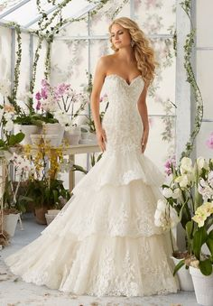 The biggest perk of my position? Getting to swoon over incredible wedding dresses day in and day out. My current obsession? The Mori Lee by Madeline GardnerSpring 2016 collection. Without a doubt, these floral, feminine   sexy gowns will make every bride feel incredible on her big day. The 2016 collections feature perfectly placed ruffles, […]
