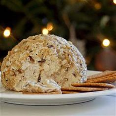 Traditional Christmas Cheeseball  1 1/2 (8 oz) pkgs cream cheese, softened  1 (2.5 oz) pkg thinly sliced smoked beef, chopped  1 (2.25 oz) can pimento green olives, chopped   1 small Vidalia onion, minced   2 dashes Worcestershire sauce  1 c chopped walnuts    Mix all ingredients except nuts. Form into a semi-ball shape. Cover and refrigerate until firm, at least 2 hours.   Place a large sheet of waxed paper on a flat surface. Sprinkle with nuts. Roll the cheese ball in nuts.