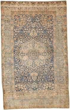 A Kerman rug South Central Persia size approximately 4ft. 8in. x 7ft. 3in.