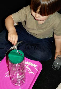 Tot trays- Montessori inspired activities. A better place for Q tips than down the heating registers.  :)