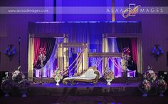 Indian wedding stage at the Gaylord Palms in Orlando, FL. Lighting by keventlighting.com. Photo by asaadimages.com #indian #wedding #decor #indianwedding #hinduwedding #sangeet #keventlighting #gaylordpalms
