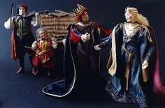 Jill Bennett's miniature dolls done in various century period dress.