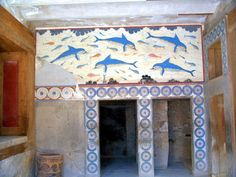 A modern copy of the ancient Minoan dolphin fresco is installed in place of the original dating from 1500 BC at Knossos palace, Heraklion (Iraklion), Crete, Greece, Europe.