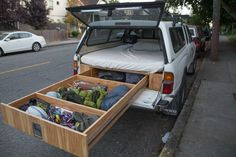 A bed pad is added to the top of the box, so the driver can actually live in their car. Genius!