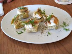 Scones topped with smoked trout and cream cheese.