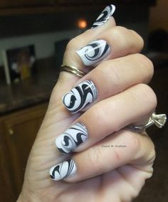 This black and white water marble design on Diane Graham's custom-fit nails is beautiful! Follow Diane at http://pinterest.com/simmi5/ to see all her fab nail art, and get your own set of beautiful and everlasting custom-fit nails at http://www.customnailsolutions.com/ .