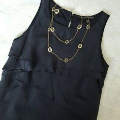 "Banana Republic Navy Blue Silk Dress Beautiful navy dress with asymmetrical tiers from Banana Republic. Brand new with tags. 100% silk  Comes with extra buttons.  Measures 33 1/2"" in length. Bust 16"" across. 🎉HP @donnadiddy 🎉HP @sauvignon Banana Republic Dresses"