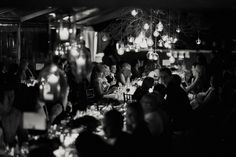reception: twigs, hanging candles and light bulbs over bridal table