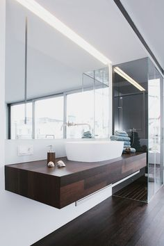 Open Bedroom/Bathroom. Suspended sleek vanity unit with flash fitted mirror cabinet